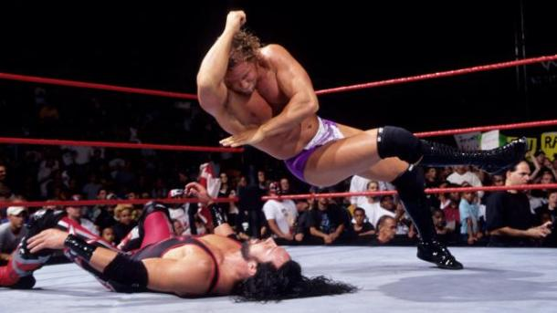 Val Venis drops an elbow on X-Pac. PHOTO COURTESY FROM WWE.COM