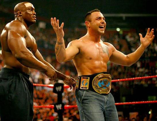 "Santino Marella, right, has his newly won Intercontinental Championship wrapped around his waist by Bobby Lashley in what was Santino's first match in WWE and what would later be known as the 'Milan Miracle"". PHOTO courtesy of wwe.com"