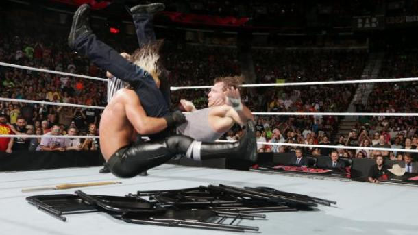 Seth Rollins powerbombs Dean Ambrose on top of a pile of chairs on Monday Night RAW on August 18, 2014. PHOTO: Wwe.com