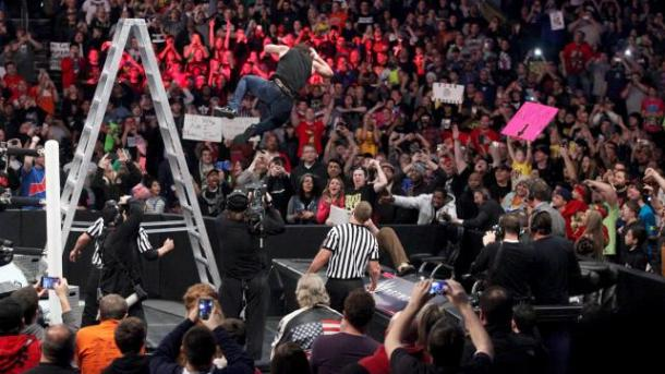 Dean AMbrose leaps off a ladder and lands an elbow drop on Bray Wyatt at the WWE TLC PPV on Sunday, Dec. 14, 2014. Photo: WWE.com