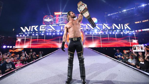 Seth Rollins hoists the WWE World Heavyweight championship at Wrestlemania 32 in Santa Clara, California. Photo: wwe.com