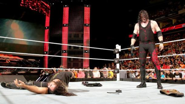 Kane lays out Seth Rollins on WWE RAW on September 28, 2015. PHOTO: wwe.com