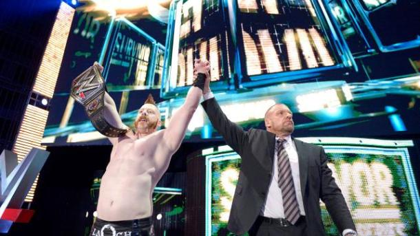 Triple H celebrates with Sheamus after he wins the WWE World Heavyweight Championship over Roman Reigns at Survivor Series on Nov. 23 2015. PHOTO: wwe.com